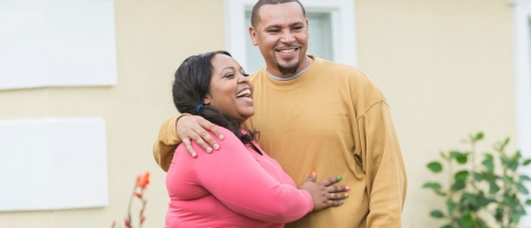young-black-couple-standing-outside-home-598227902_7360x4912.jpeg